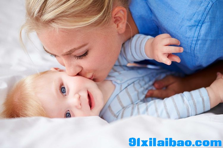 bigstock-Mother-Kissing-Baby-Son-As-The-59960840.jpg